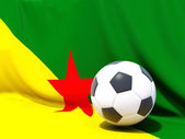 Flag of french guiana with football in front of it — Stock Photo