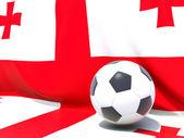Flagga georgien med fotboll framför den — Stockfoto