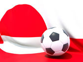 Flag of greenland with football in front of it — Stock Photo