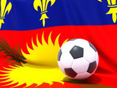 Flag of guadeloupe with football in front of it — Stockfoto