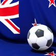 Stock Photo: Flag of new zealand with football in front of it