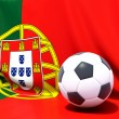 Stock Photo: Flag of portugal with football in front of it