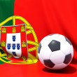 Flag of portugal with football in front of it — Stock Photo #37964637