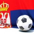 Flag of serbia with football in front of it — Stock Photo