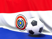 Flag of paraguay with football in front of it — Stock Photo