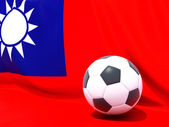 Flag of republic of china with football in front of it — Stok fotoğraf