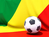 Flag of republic of the congo with football in front of it — Stok fotoğraf