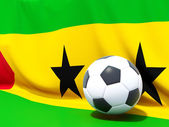 Flag of sao tome and principe with football in front of it — ストック写真