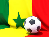 Flag of senegal with football in front of it — Stock Photo