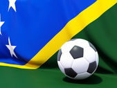 Flag of solomon islands with football in front of it — Foto de Stock