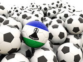 Football with flag of lesotho — Stock Photo