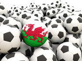 Voetbal met vlag van wales — Stockfoto