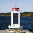 Solar Panels Powering Navigational Light Marina Ocean — Stock Photo