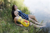 Two Women Outdoors River Dresses Feet In Water — Stock Photo