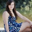 Stock Photo: Young Plump CaucasiWomOutdoors Dress Sitting