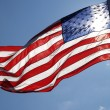Unites States Flag Streaming With Sun Behind It — Stock Photo