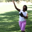 Young African American Woman Throwing baseball Park — Stock Photo #33203449