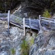 Stock Photo: Wooden Stairs Going Up Cliff Wall Beach