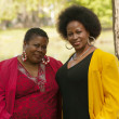 Two Older Black Women Outdoor Portrait Red Yellow — Stock Photo #38942643