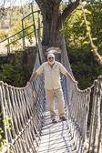 Man standing on suspension bridge — Stock Photo