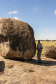Afro american man standing near huge rock — Stock Photo