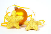 Yellow Bbauble and stars — Stock Photo