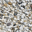 Smooth pebbles on beach — Stock Photo