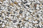 Smooth pebbles on beach — Stock Photo