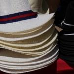 Summer hats on market stall — Stock Photo #50777611