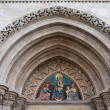 Stock Photo: Madonnwith Child on Matthias Church Tympanum