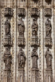 Sculptures of Saints on Seville Cathedral Facade — Stock Photo