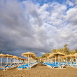 Sun Loungers on Marbella Beach - Stock Photo