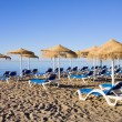 Sun Loungers on Marbella Beach — Stock Photo