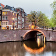 Canal Bridge in Amsterdam at Evening — Stock Photo #26831437