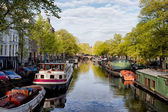 Boats on Amsterdam Canal — Stock Photo