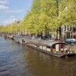 Houseboats on a Canal in Amsterdam — Stock Photo