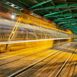 Stock Photo: Steel Truss Bridge with Tram Light Trail