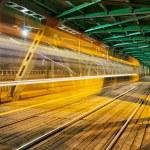 Steel Truss Bridge with Tram Light Trail — Stock Photo