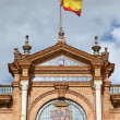 Spanish Flag and Crest on Plaza de Espana Pavilion in Seville — Stock Photo