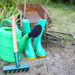 Instruments for work in a garden is a watering-can, rubber knee- — Stock Photo