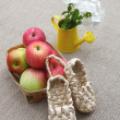 Rural still life with apples and sandals made of bark - Stock Photo