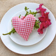 Romantic serving with a bouquet of petunia and heart — Stock Photo