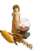 Doll from the leaves of corn with the sheaf of wheat and corn — Stock Photo