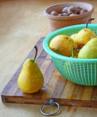Yellow pears and walnuts on a table — Stock Photo