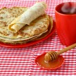 Cup of tea with the pile of pancakes and honey - Stock Photo