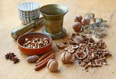 Split nuts and age-old mortar on a wooden table — Stock Photo