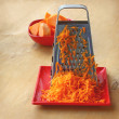 A grater and pieces of pumpkin — Stock Photo