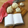Open notebook with cauliflower and garlic — Stock Photo