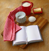 Recipe book on the table in the kitchen — Stock Photo