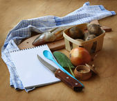 Opened notebook and ingredients for lean fish dinner — Stock Photo